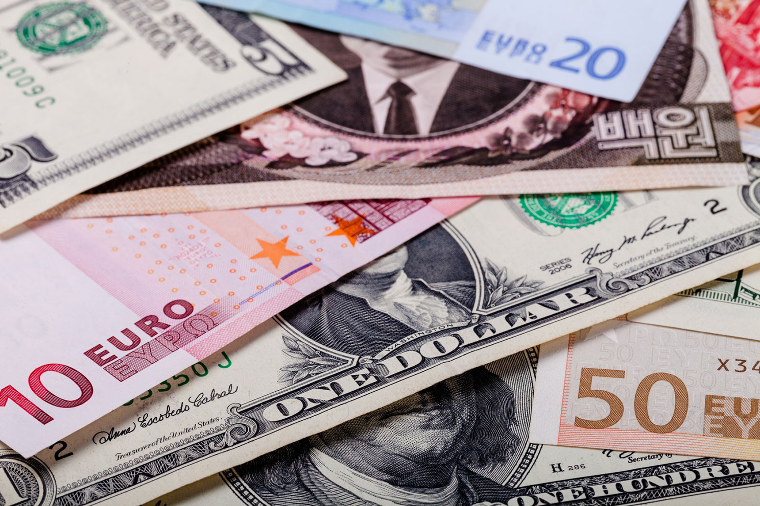 Is it necessary to exchange American currency for the currency of the destination country?
